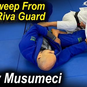 How To Do The Perfect Side Sweep From De La Riva Guard by Mikey Musumeci